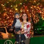 Estebán Chacón, 2, and his aunt Jimena Chacón stand under the Christmas tree at the Children's Hospital on Thursday, December 3, 2015.