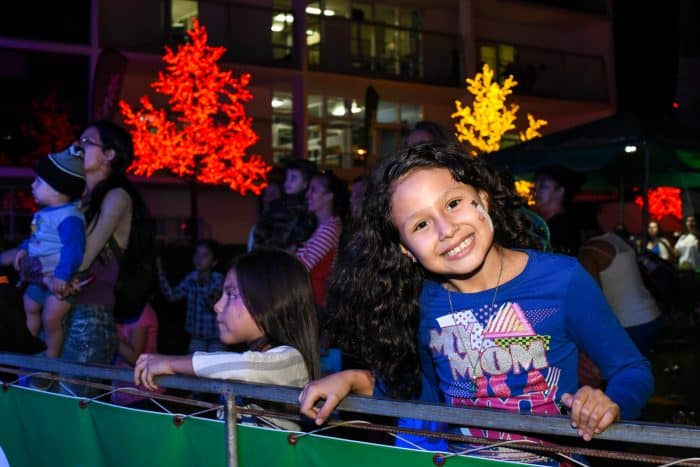 Camilia Rojas, 10, enjoyed the music under the Christmas tree outside San José's Children's Hospital.