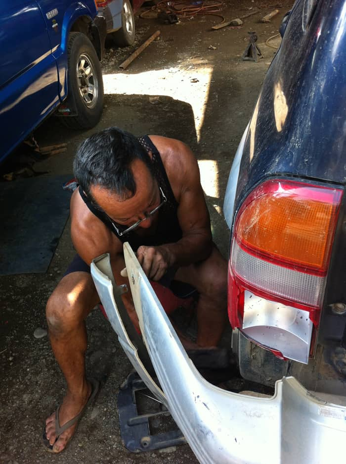 Jorge hard at work, reattaching our bumper.