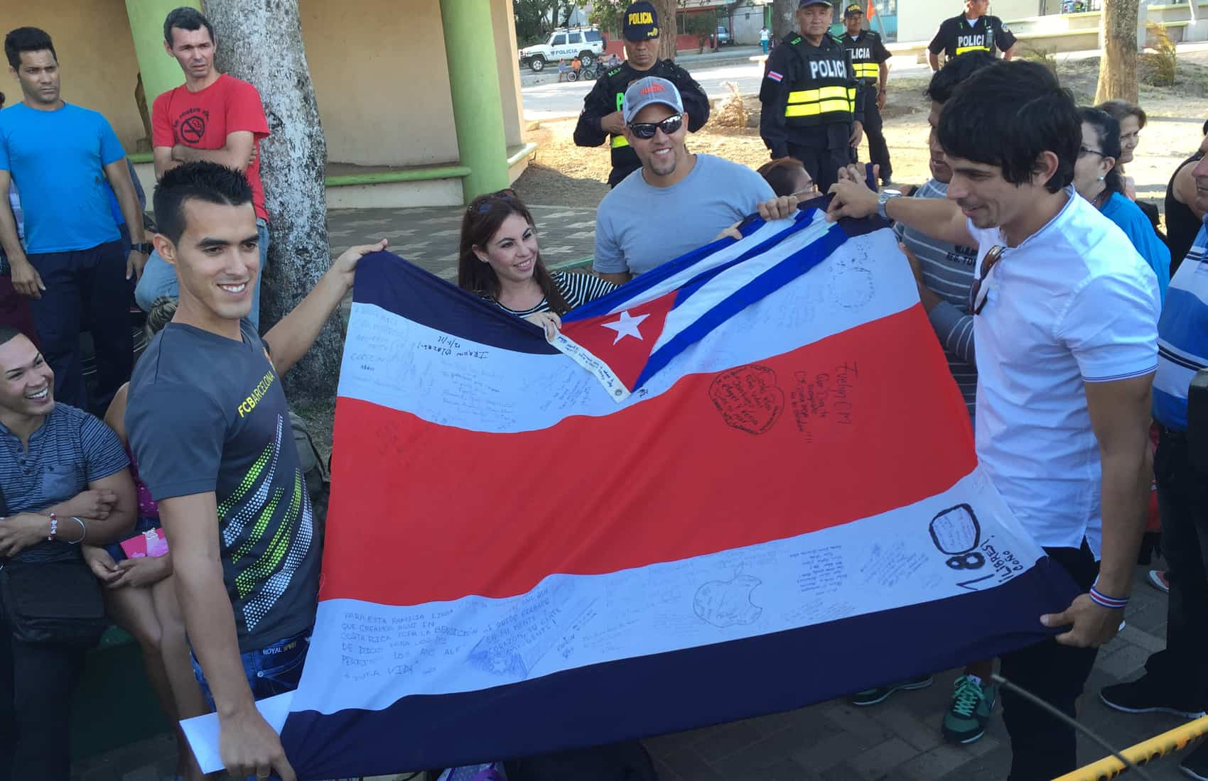 Cuban migrants hold flags from Cuba and Costa Rica