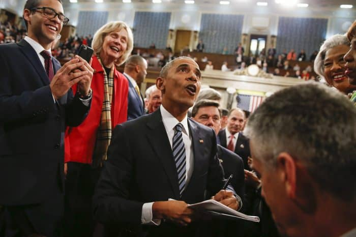 State of the Union: U.S. President Barack Obama looks up at the balcony