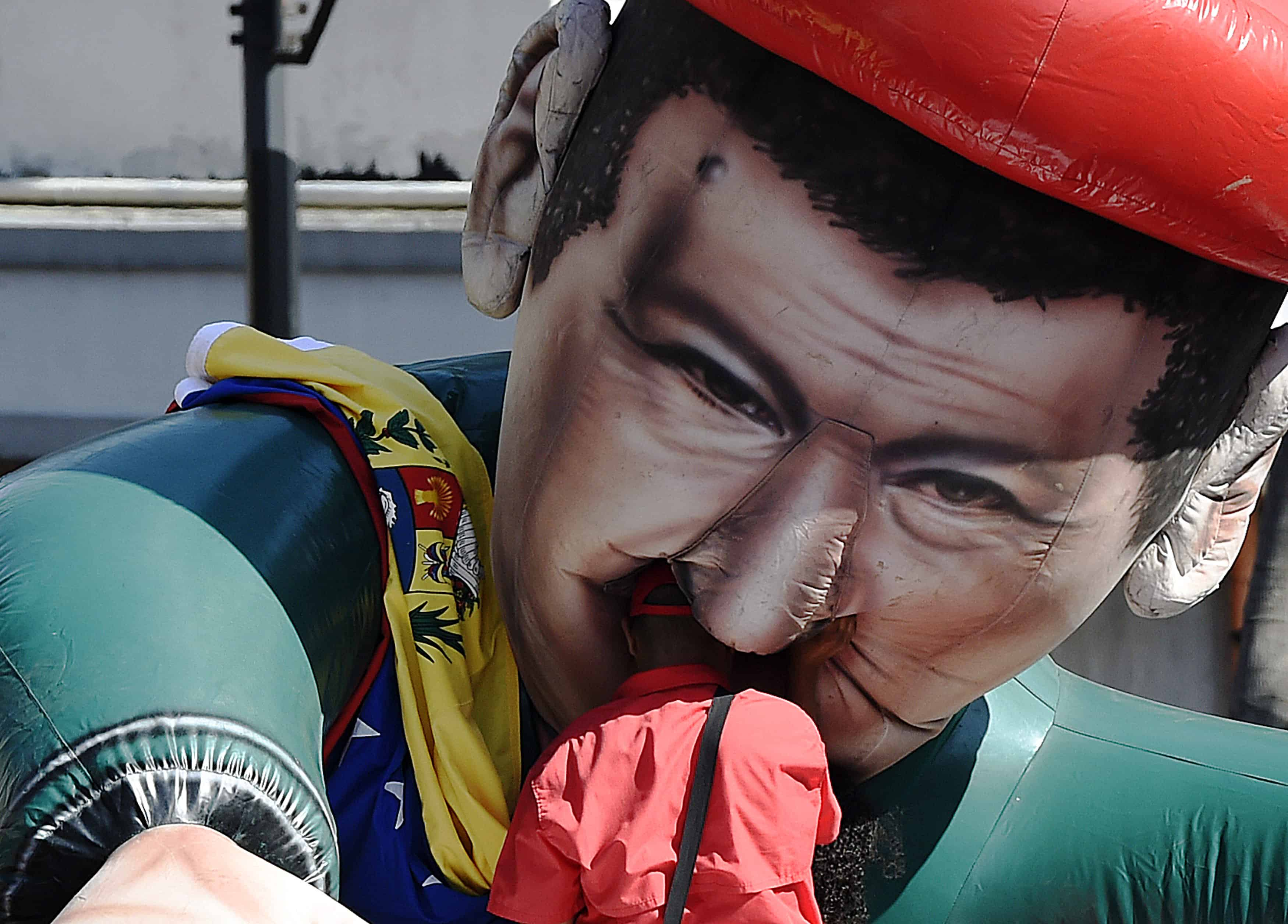 Venezuela crisis: A man and an inflatable doll depicting late Venezuelan President Hugo Chávez