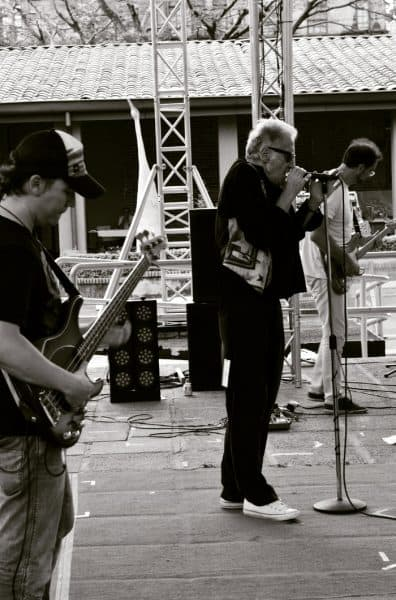 Rooftop concert? The Blind Pigs belt it out, with Dave Scott front and center.