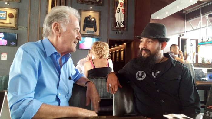 Dave Scott, 73, leader of the Blind Pig Blues Band, talk to Fausto Solano, general manager of the Hard Rock Café, San José, Costa Rica.