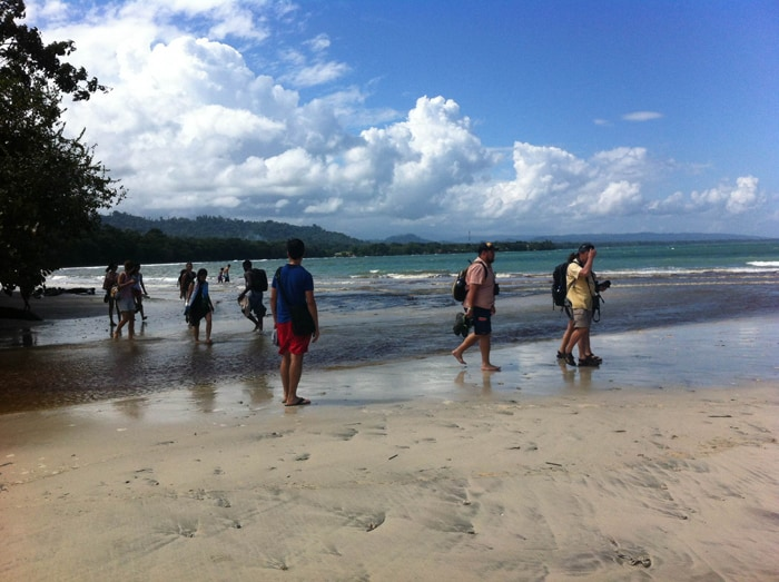 Some wading required: Crossing a shallow river at Cahuita.