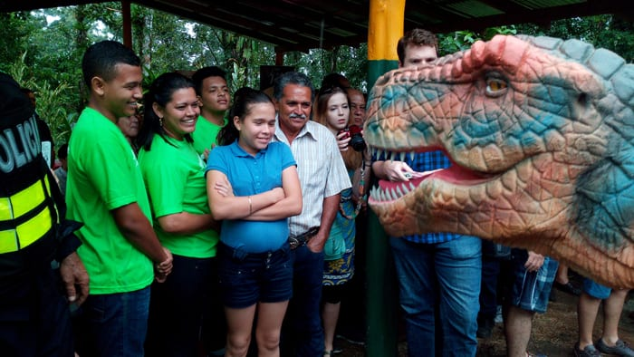 A walking T. rex greets visitors to Dino Park.