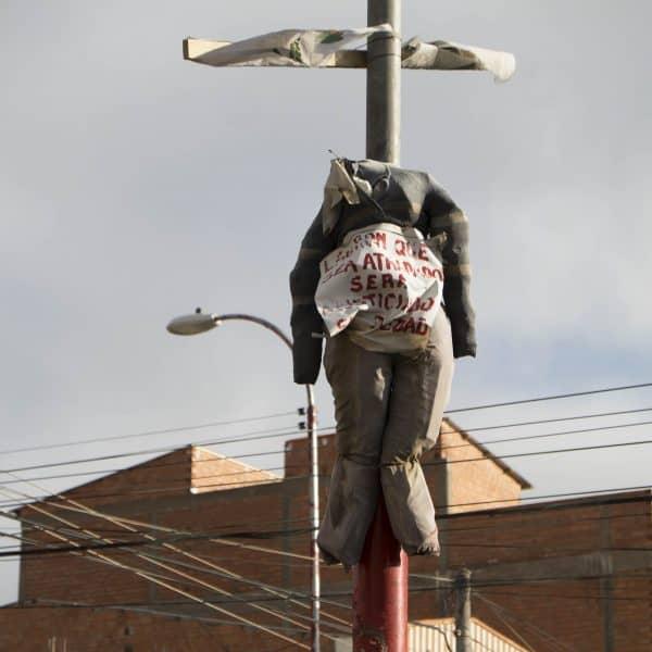 Peru vigilantes   Bolivia hanging doll