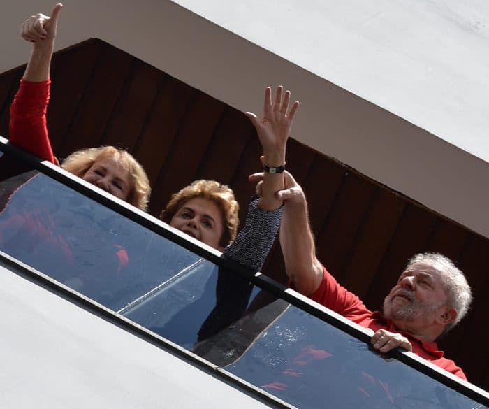 Former Brazilian President Luiz Inacio Lula da Silva, right, current President Dilma Rousseff, center, and Lula's wife Marisa Leticia