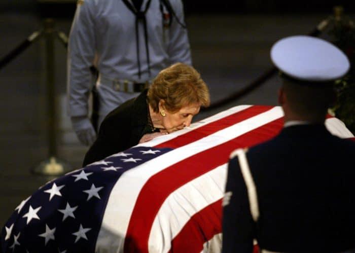 Nancy Reagan kissing Ronald Reagan's casket