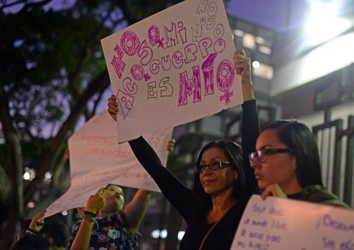 sexual harassment protester holding sign