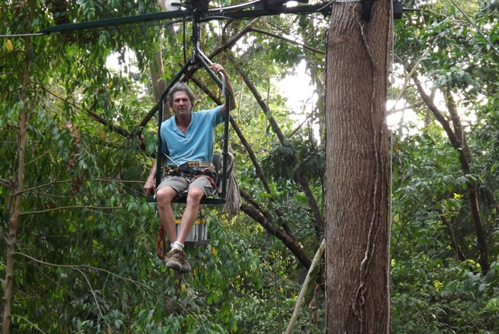 """Don Perry sitting on what he considers """"the future of canopy exploration."""""""