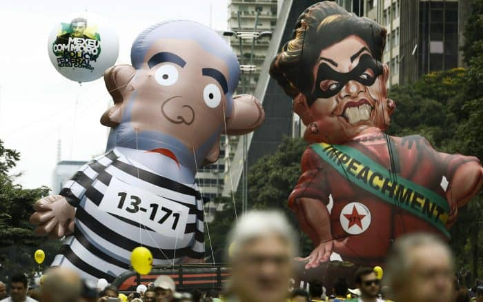 Protesters in Brazil hold giant dolls of Lula and Dilma Rousseff