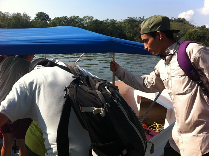 Tour guide Boanerges Gamboa helps tourists climb into the boat.