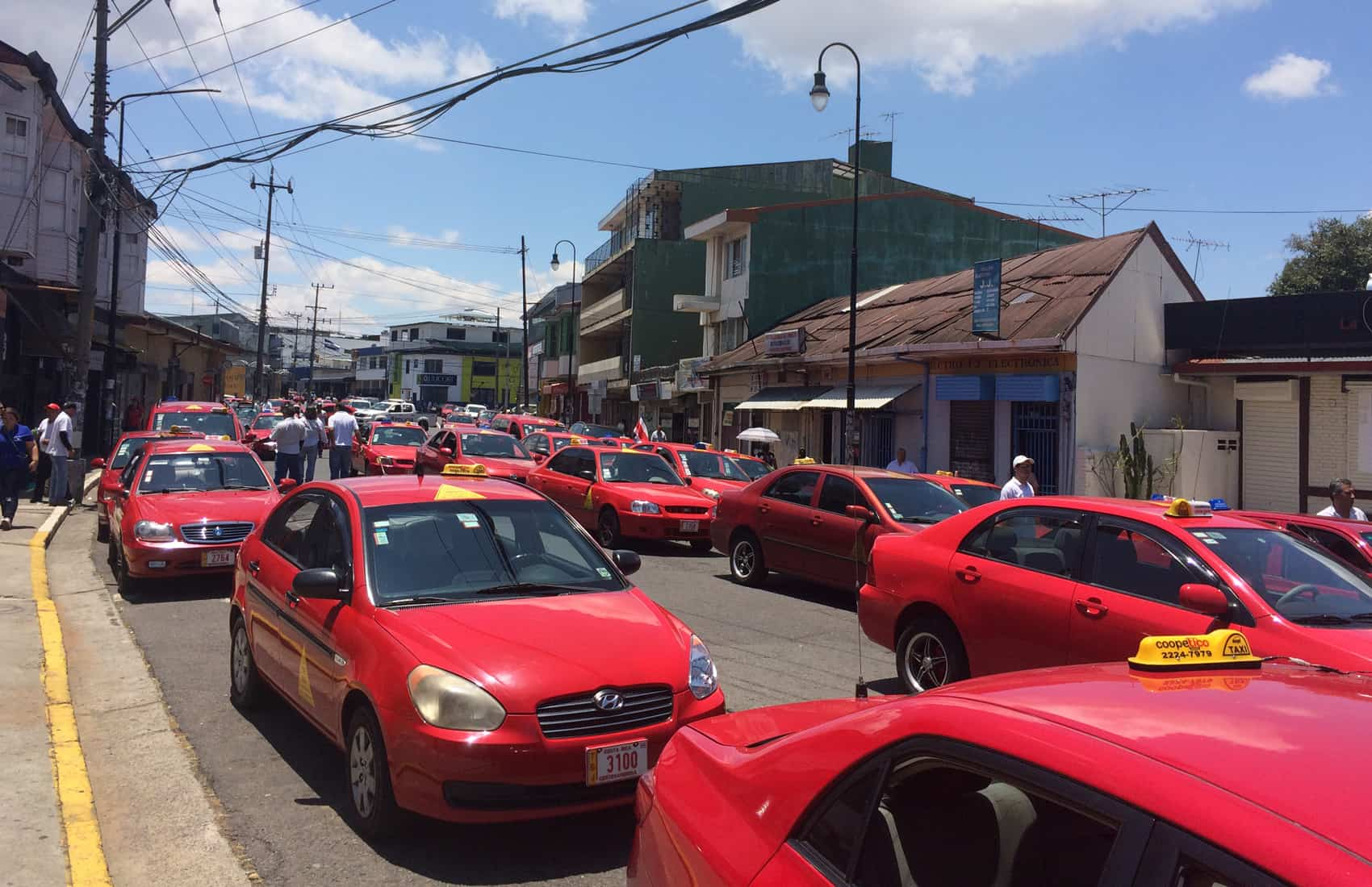 Taxis protest Uber by blocking traffic