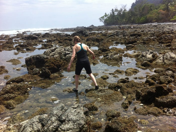 Cindy picks her way through the tide pools.