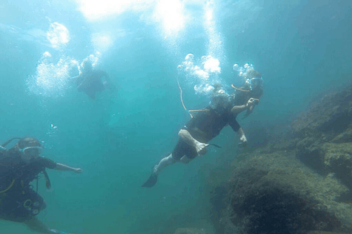 Snuba divers plunge into the water off Catalina Island.
