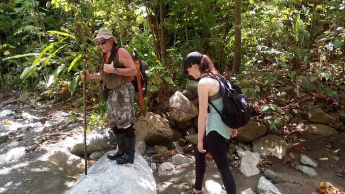 At Río Carate, Paul warns against slipping on rocks and breaking an ankle.