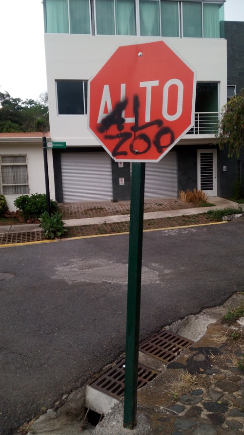"""Graffito on a stop sign near the zoo says """"Stop the Zoo."""""""