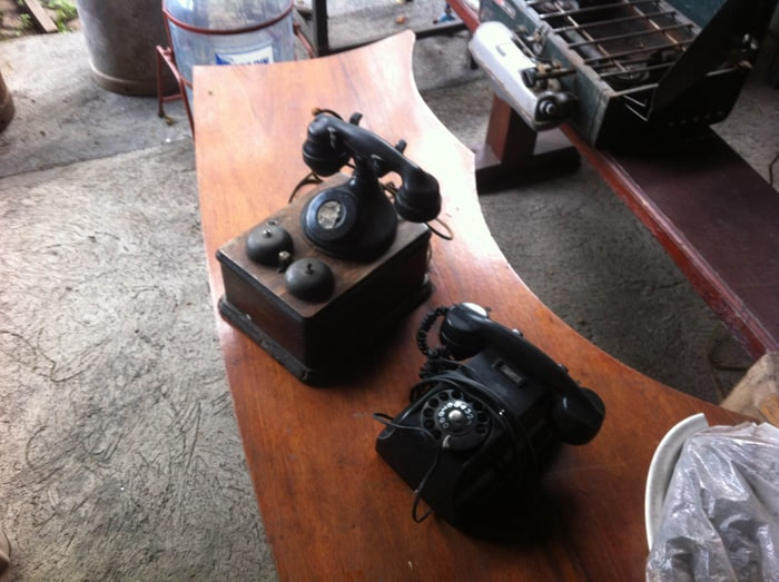 The old telephone, left, is said to be the oldest antique at Antiguedades Santa Ana.