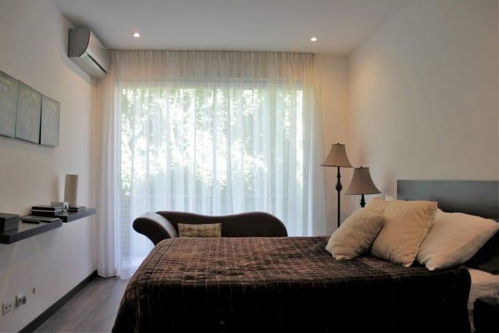 Bedroom at condo for rent at Nova Lofts.