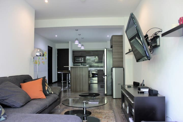 Living room at condo for rent at Nova Lofts.