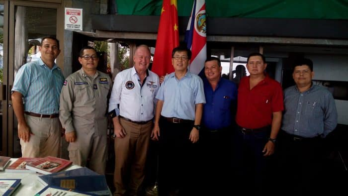 Chinese Ambassador Song Yanbin, center, with officials of the municipality of Quepos, the Coast Guard Academy, Palma Tica palm oil company and the Chamber of Commerce.