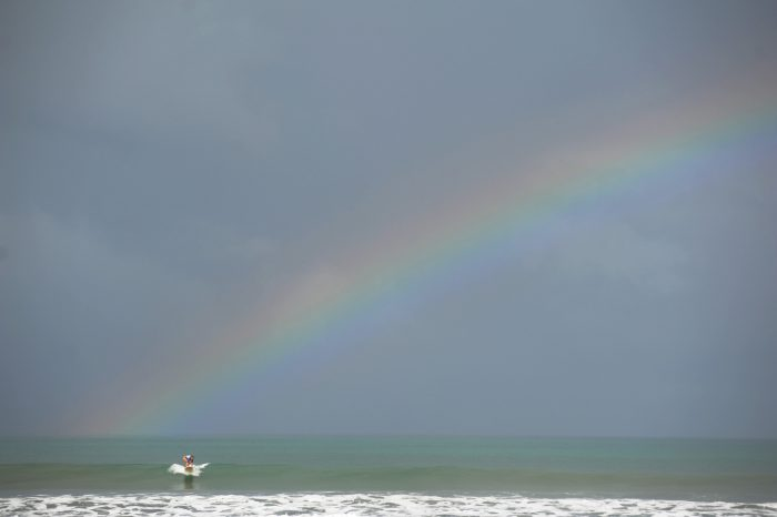 rainbow and surfer