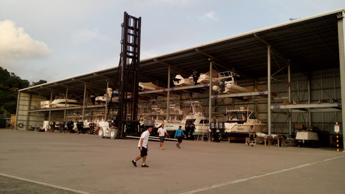 """Beast,"" the huge forklift, stands ready to raise and lower boats from the dry rack in the Marina Pez Vela yacht yard."