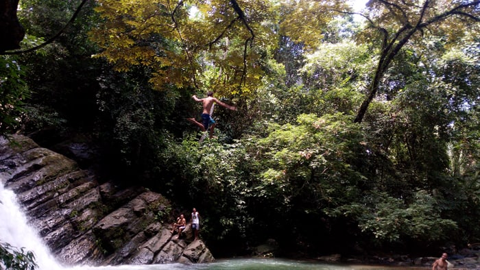 Going airborne on a rope swing at Poza Azul.