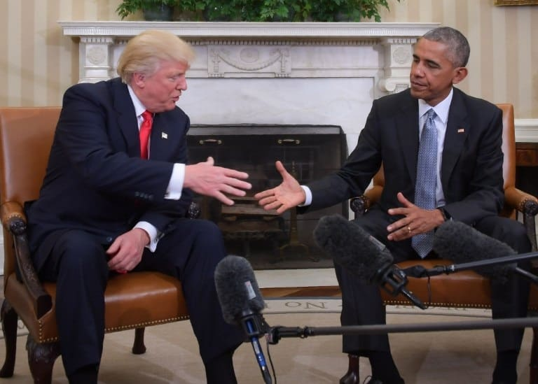 US President Barack Obama and Republican President-elect Donald Trump shake hands during a transition planning meeting in the Oval Office at the White House on November 10, 2016 in Washington,DC. /