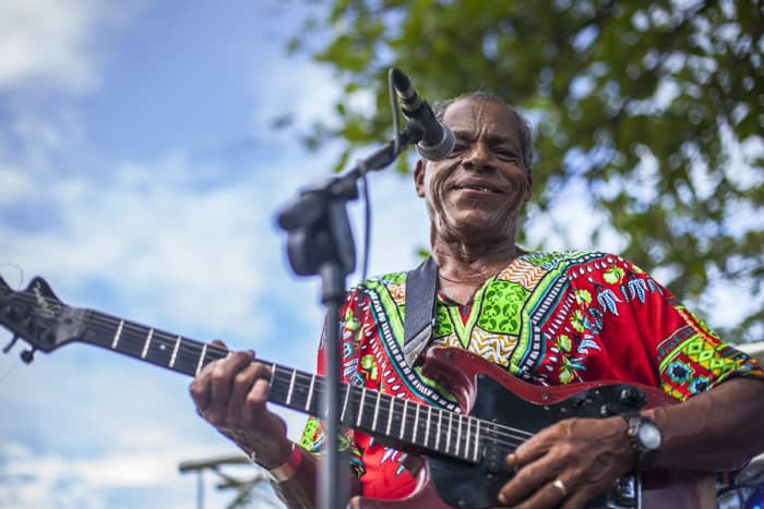A guitar player singing calypso music at a festival in Puerto Viejo.