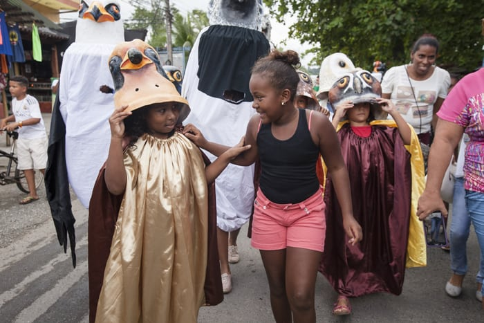 Two girls walk together in the first-ever Parade of the Birds.