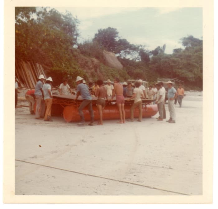 An old photo showing a raft used to bring materials ashore in the 1970s.