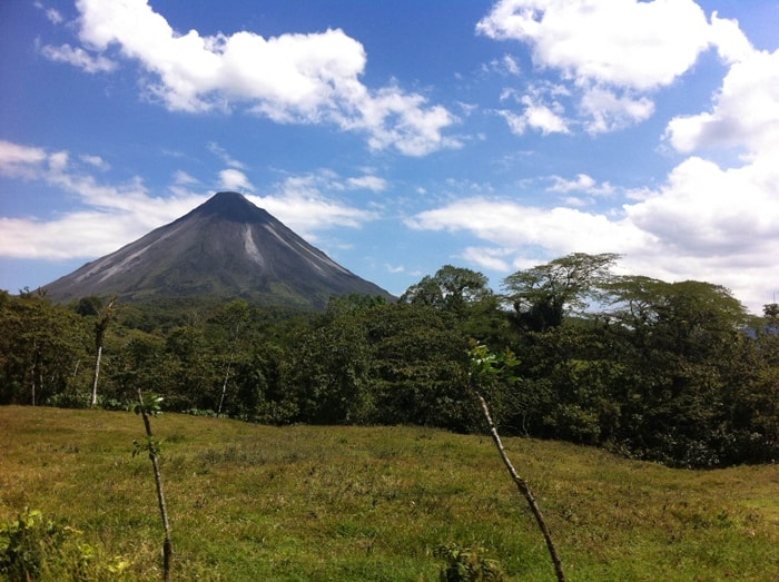 Roadside view of Volcán Arenal, a nearly perfect cone and the perfect backdrop for all kinds of adventure.