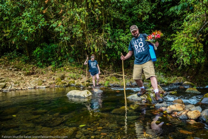 The T-shirt says it all at this wedding with a river crossing.