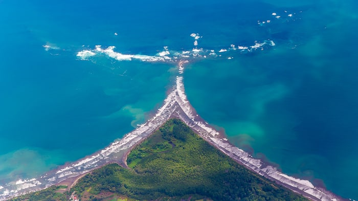 "Airplane view of Ballena Marine National Park with its distinctive ""whale tail"" landmark."