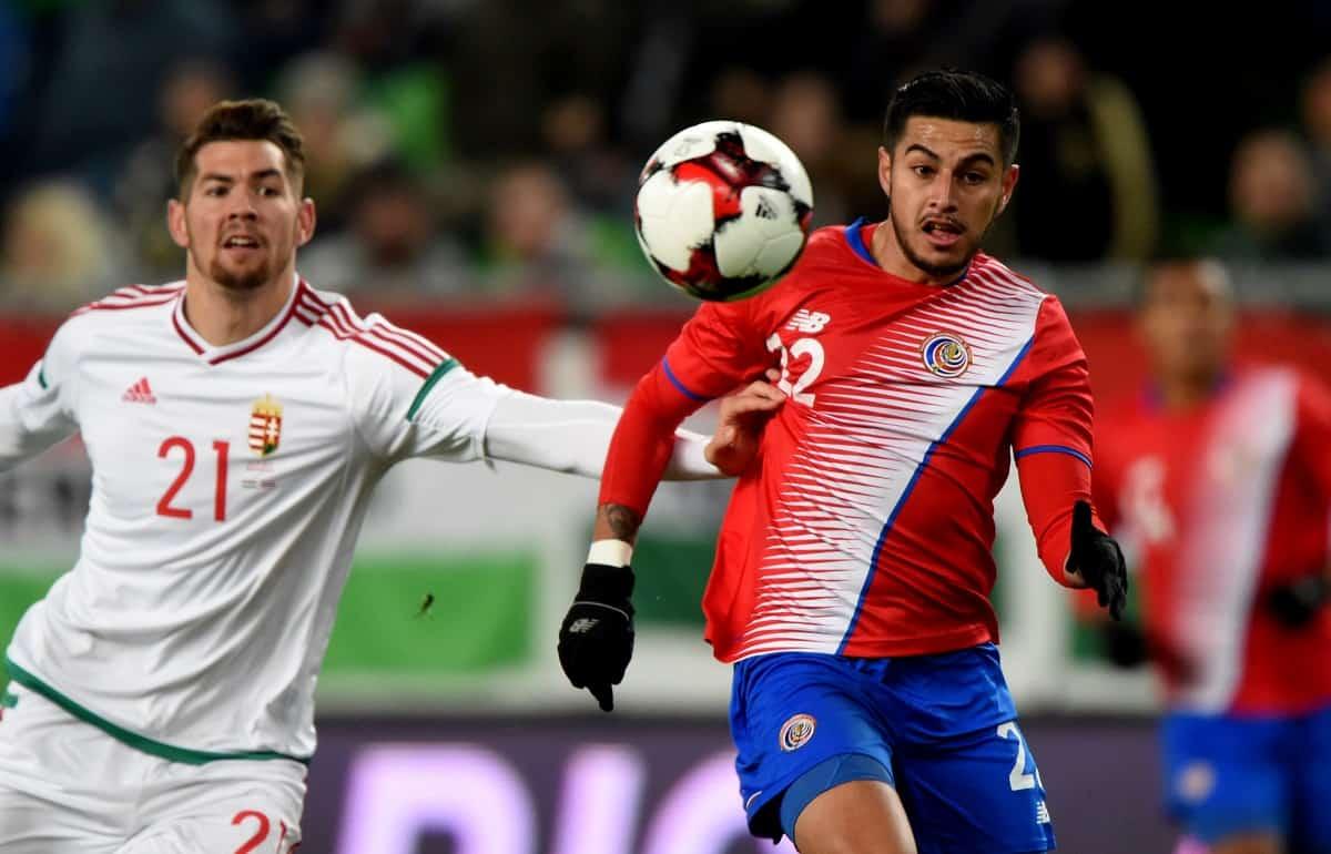 Costa Rica's Ronald Matarrita (R) vies with Hungary's Barnabas Bese
