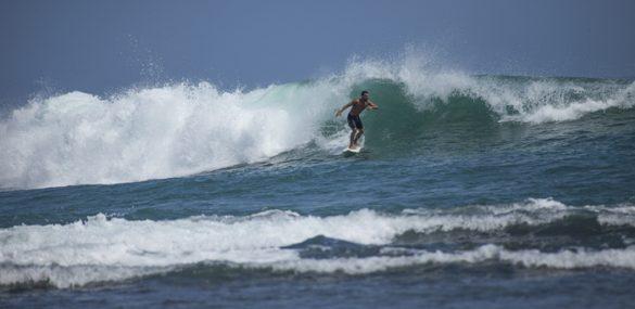 A sufer catches a wave in Puerto Viejo, Costa Rica.