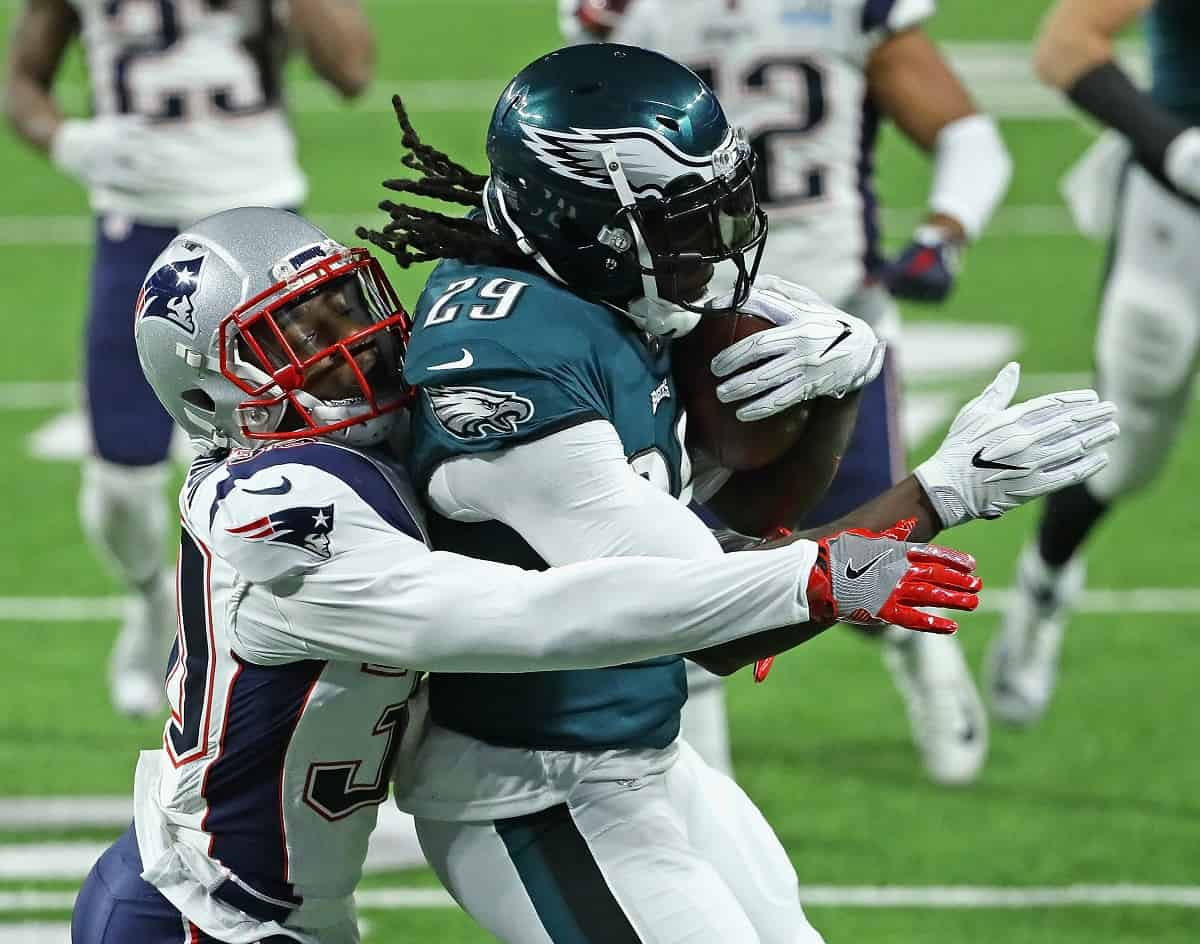 Duron Harmon, left, of the New England Patriots, tries to bring down LeGarrette Blount of the Philadelphia Eagles during Super Bowl Lll at U.S. Bank Stadium on Feb. 4, 2018 in Minneapolis, Minnesota.