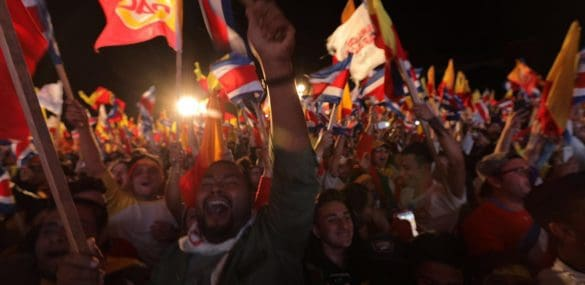 Supporters of Carlos Alvarado celebrate at the Plaza Roosevelt when the results are announced.