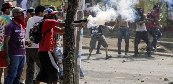 Students clash with riot police agents in Managua, Nicaragua on April 21, 2018.