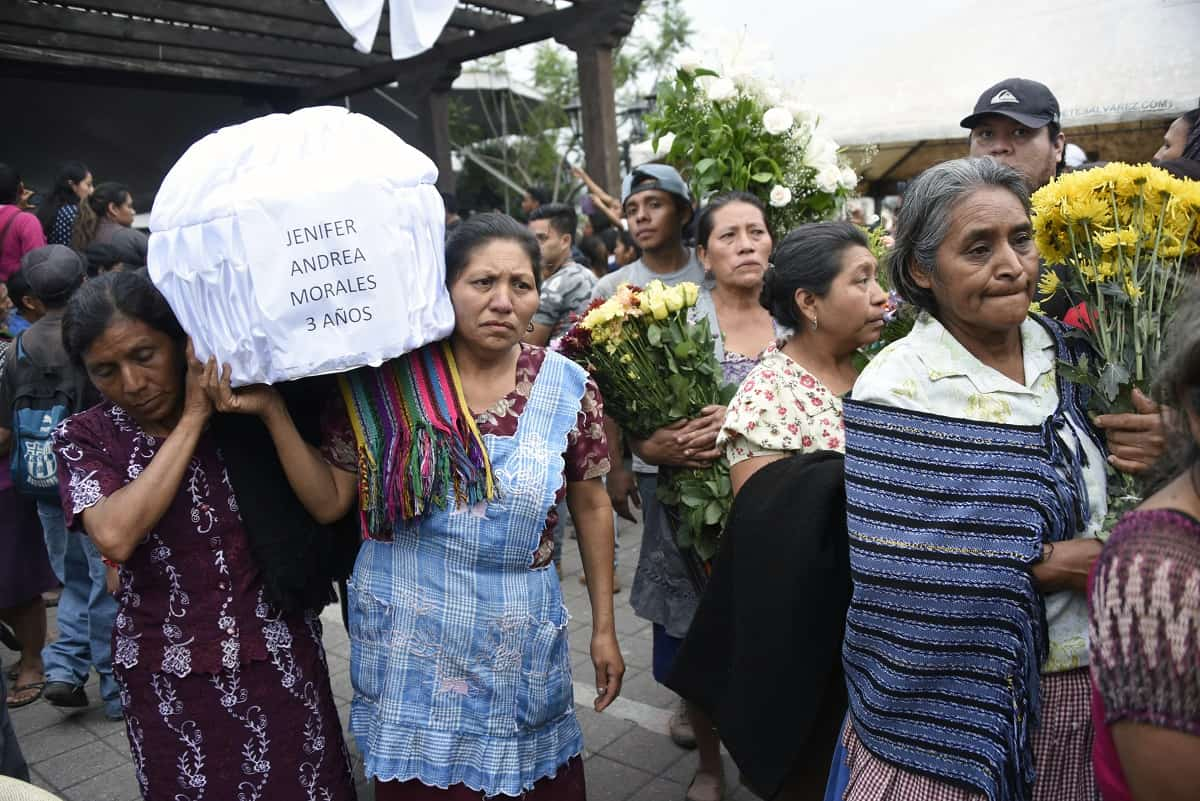 Women carry the coffin of a three-year-old victim of the Volcán Fuego eruption in Guatemala.