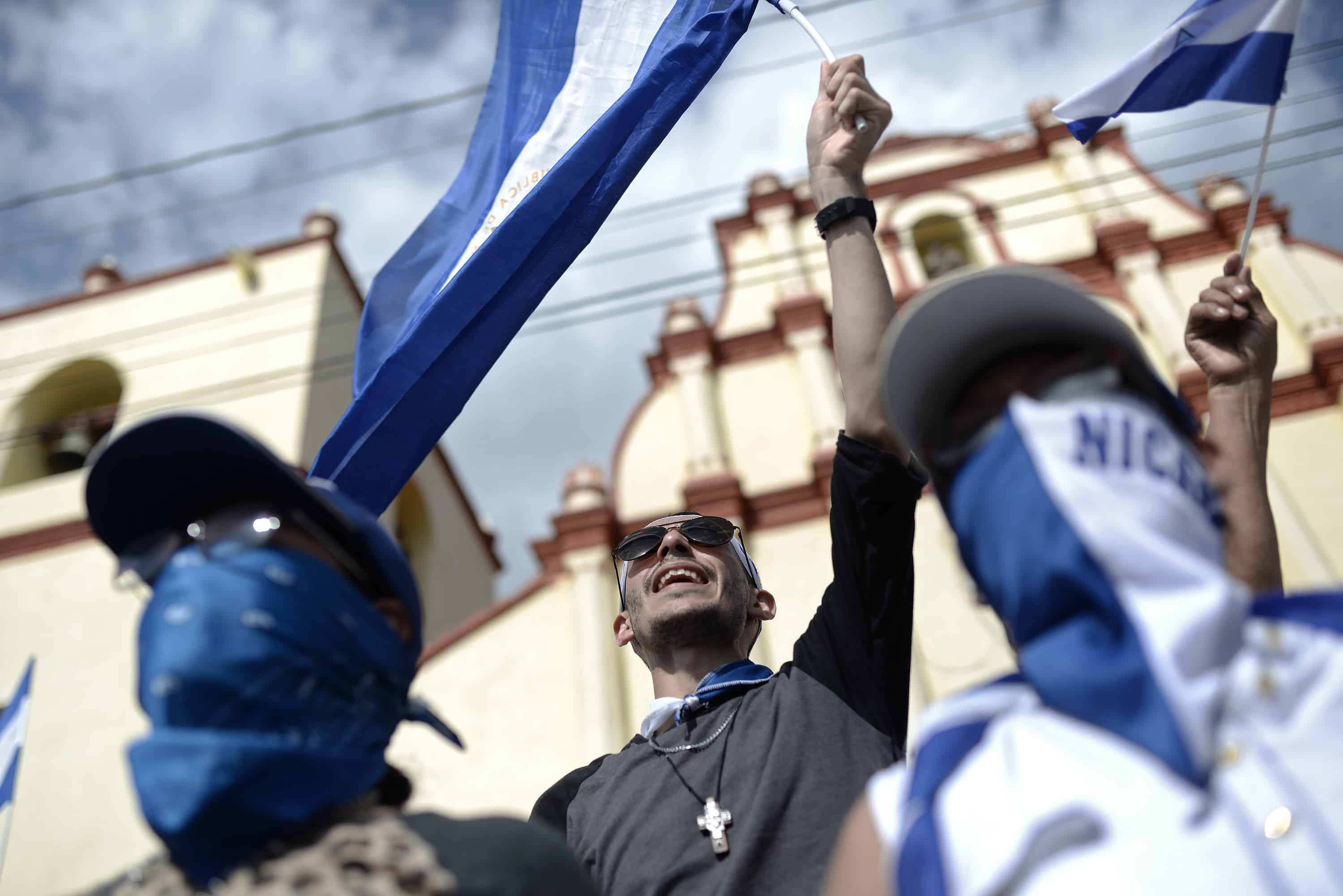 "Protesters participate in the ""March of Mocking"" against Nicaraguan President Daniel Ortega and his wife, Vice-President Rosario Murillo,"