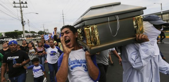 Friends and relatives carry the coffin containing the body of the student Gerald Velazquez, shot dead during clashes with riot police in a church near the National Autonomous University of Nicaragua (UNAN) in Managua,on July 16, 2018.