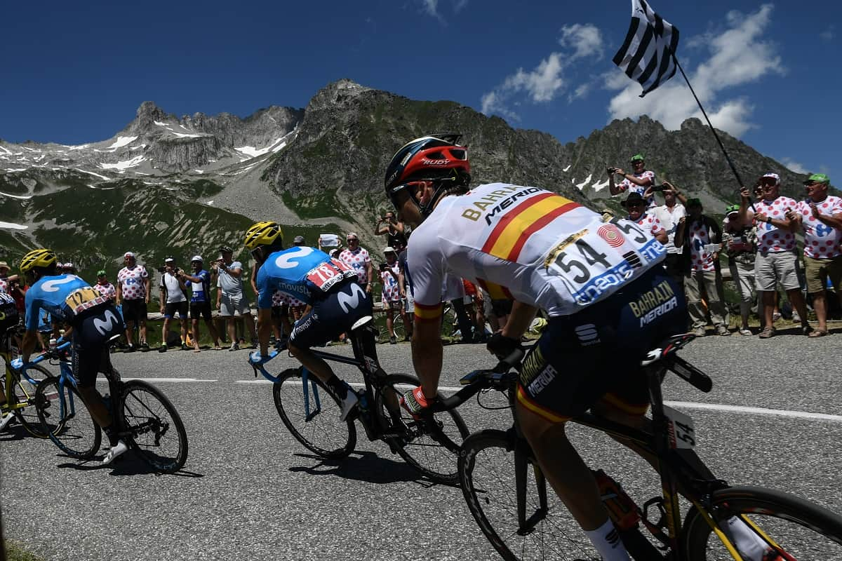 From left, Costa Rica's Audrey Amador, Spain's Alejandro Valverde and Spain's Gorka Izagirre ride up the Col de la Madeleine pass during the twelfth stage of the 105th edition of the Tour de France cycling race, between Bourg-Saint-Maurice - Les Arcs and l'Alpe d'Huez, on July 19, 2018.