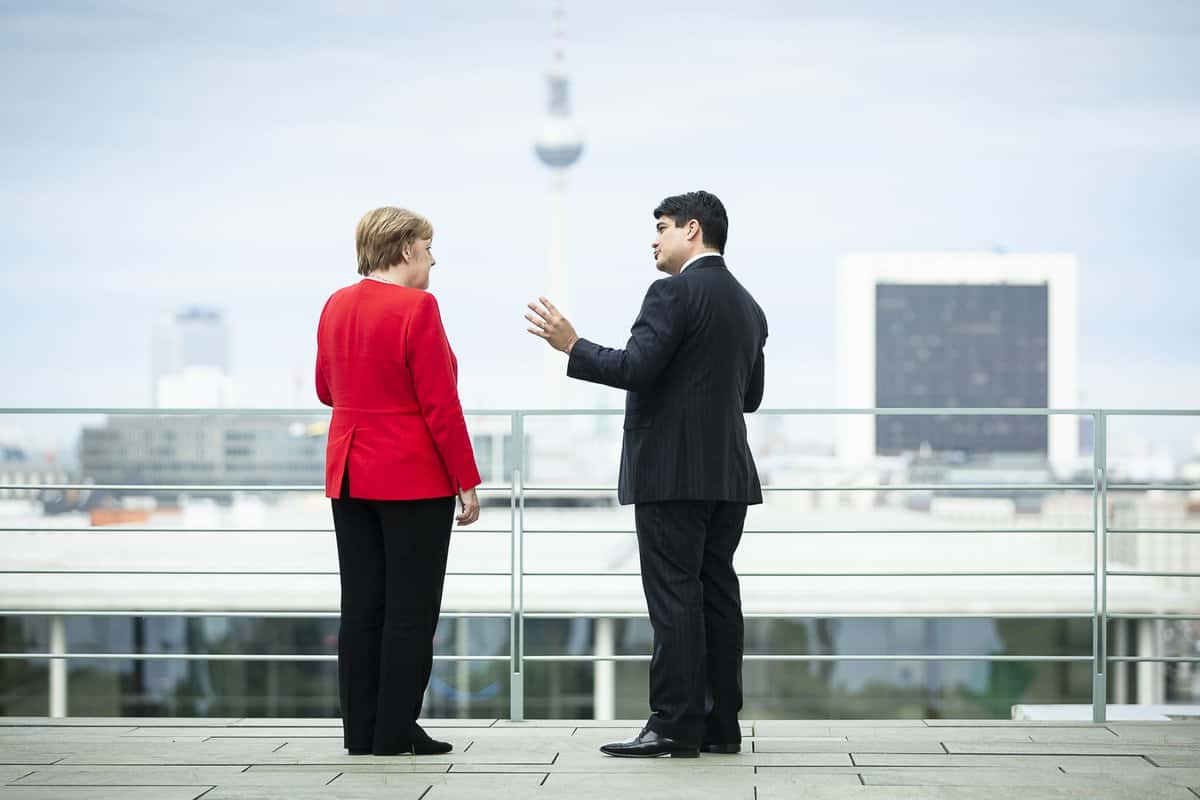 Carlos Alvarado and Angela Merkel