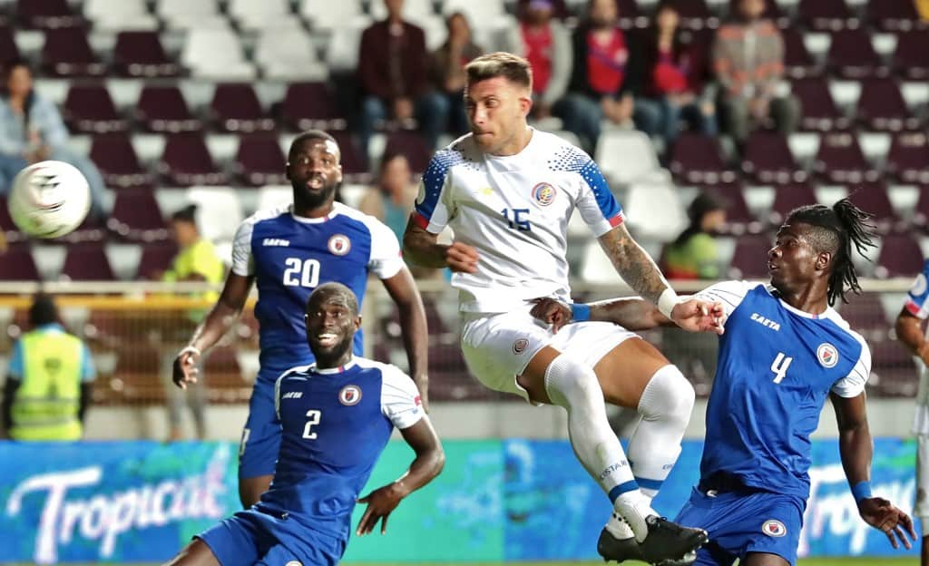 Costa Rican player Francisco Calvo (C) scores against Haiti