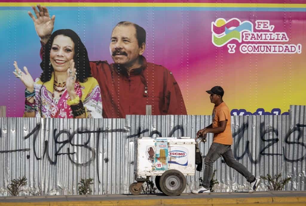 A mural showing Daniel Ortega and Rosario Murillo