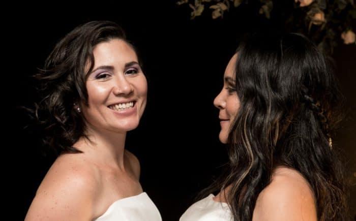 Newlyweds Alexandra Quiros (L) and Daritza Araya in Costa Rica