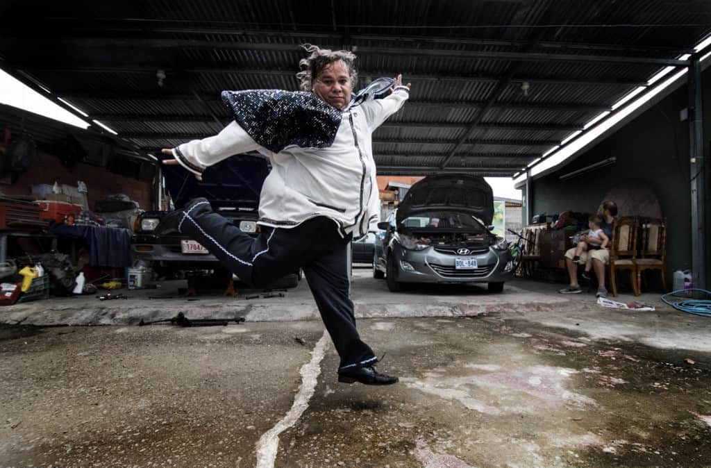 Costa Rican Alberto Lizano performs impersonating Mexican late singer Juan Gabriel, at the vehicle repair shop where he now works in San Jose, on July 21, 2020.